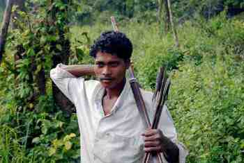 Bow and arrow wielding member of the Maoists' village militia, known as Sangam, that tries to protect the Maoist movement in the Bastar region of Chhattisgarh state, India.