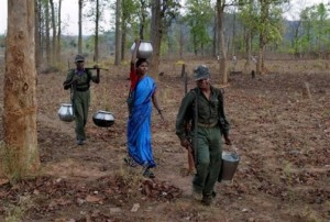 Moiast activists carry drinking water from a village well in the Abujh Marh in the central Indian state Chhattisgarh April-13-2007
