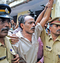 In High Spirits- Malla Raji Reddy, central committee member of the Communist Party of India (Maoist), shouting slogans as the police take him to the Judicial First Class Magistrate-II,Aluva, Kerala