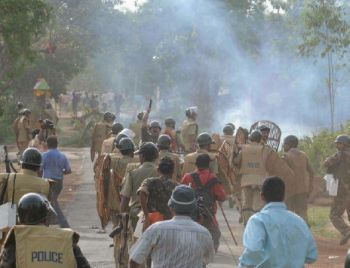 Police, backed by CRPF personnel, chase supporters of the People's Committee Against Police Atrocities near Pirakata, en route to Lalgarh, on Thursday.