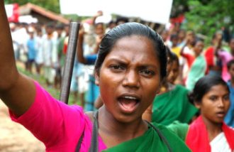 An activist of Maoist rebel group shouting slogans while leading a procession of tribal villagers to pay tribute to their activist killed in confrontation with security forces to mark 'Martyr's-Week' at an unidentified place inside the deep forests in Dantewada district of Chhattisgarh