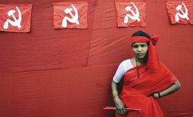 RED SIGNAL, A woman naxalite waits before her performance at a protest rally in Kolkata