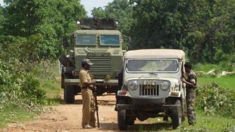 A mineproof vehicle carrying the CoBRA unit forces patrol into the jungles of Bastar, Chhattisgarh.