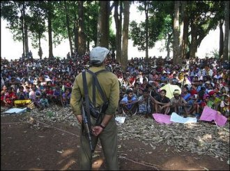 A senior Naxalite commander known as Comrade Kosa addresses about 5,000 tribal militiamen and supporters at an April rally near Bastar, India
