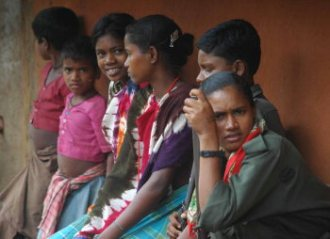 Maoist soldiers accompanied with village girls
