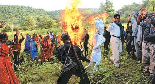 Oct 13, '09: Villagers watch as Maoists burn effigies of Sonia Gandhi and Manmohan Singh in Dumariya, Gaya district, Bihar