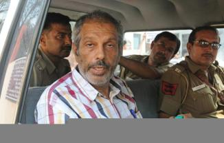 Maoist leader Kobad Ghandy being taken to a hospital in New Delhi on Wednesday.