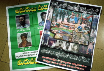 PIC FROM VIZAG--- Two posters, part of the publicity campaign launched  by the district police against the CPI (Maoist) and to wean away Girijans from naxalites. The posters and a broucher are being released in the agency area while about 240 Girijans are being informed through post cards that cases against them have been lifted.---Photo: C.V. Subrahmanyam. (Digital Image) 28/09/2005