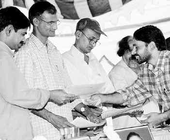 Representative of a minority organisation submitting a memorandum to the CPI (ML) Peoples War leaders - Ramakrishna and Sudhakar -- and the Janashakti leader, Riyaz, at a meeting organised at Hydrabad-2004