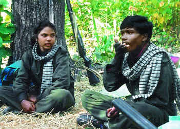 Cadre of the CPI(M-L) People's War take a break from their vigil in a forest near Daltonganj in Jharkhand.