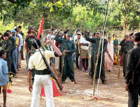 Communist Party of India (Maoist) cadre celebrate the founding day of their guerrilla wing, the People's Liberation Guerilla Army, near Chainpur in Palamu district, Jharkhand, on December 8, 2007